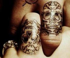 Sugar skull tattoo wedding rings (looks maybe a bit painful)
