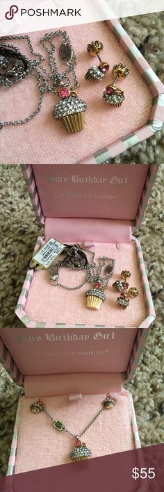 "Juicy couture cupcake necklace & earring set Juicy couture PAVE CUPCAKE wish necklace and earrings set! gold ""wrapper"", silver pave ""frosting"" and little pink rhinestone ""cherries"" ~ adorable! 16"" silver chain with 3"" extension; matching earrings with signature crown backs Necklace was $48, earrings were $42; they come in the necklace box (earrings box is missing) worn a few times, I just have too much jewelry to wear, so my loss is your gain! Good condition ~ please see pictures! any…"