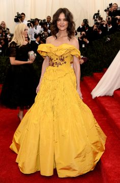 Katie Holmes lit up the red carpet in Marchesa's saffron gold silk faille hand-pleated gown. #MetGala
