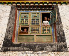 Children framed by intricately decorated windows traditional #Tibetan architecture that is fast disappearing. #Tibet #China #shangrila @natgeo @natgeocreative @thephotosociety by yamashitaphoto