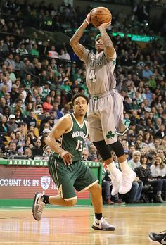Boston MA 4/12/17 Boston Celtics Isaiah Thomas knocks down a 3-point basket beating Milwaukee Bucks Malcolm Brogdon during second quarter action at TD Garden. (Photo by Matthew J. Lee/Globe staff) topic: reporter: