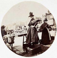 Woman at market stall, circa 1890. An early photo taken with a Kodak camera.