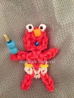BABY ELMO with a Bottle. Designed and loomed by Marlene Barressii Crafts. (Rainbow Loom FB page) Rainbow Loom Tutorials, Rainbow Loom Patterns, Rainbow Loom Creations, Rainbow Loom Charms, Rainbow Loom Bracelets, Rainbow Loom Characters, Rubber Band Crafts, Rubber Bands, Rainbow Loom Animals