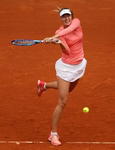Mutua Madrid Open - Day Two - Maria Sharapova of Russia plays a backhand against Timea Bacsinszky of Switzerland in their second round match during day one of the Mutua Madrid Open tennis tournament at the Caja Magica on May 3, 2015 in Madrid, Spain.