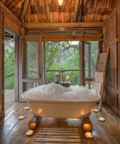 How about a bubble bath with candles in a tiny tree house hotel? Yes, please! | Tiny Homes