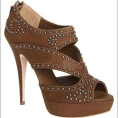 """Miu Miu Leather Studded Brown Sandals 10 NWOT Miu Miu Brown Platform Leather Studded Sandals.  5"""" heel with 1"""" platform. The model wearing the shoes wears a much smaller size.  I just had her try them on to give u an idea of what they look like on.  Size 10 NWOT Prada Shoes Sandals"""