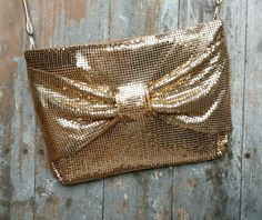 Check out this item in my Etsy shop https://www.etsy.com/listing/222251367/retro-gold-mesh-handbag-by-whitingdavis