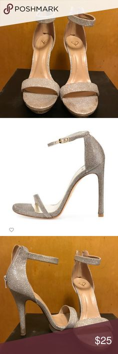 "Silver strappy sandal Silver sparkly sandal. Minimal damage only to bottom . 4"" heel Windsor Shoes Heels"