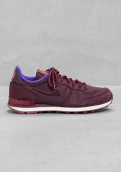 NIKE These sneakers have a retro running shoe style, combining both suede,  patent details 04c599a322