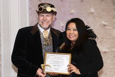 """Viscount Eastman Wesley aka """"Bob Archer"""" receiving Best Steampunk Designer/Stylist award for Steampunk AMOUR Photoshoot invitational. Images and designs found in AMOUR magazine."""