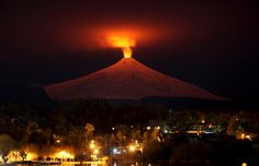 The Villarrica Volcano is seen at night from Pucon, Chile, on July 12, 2015. Villarrica, located near the popular tourist resort of Pucon, is among the most active volcanoes in South America.