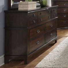 "Wood dresser in dark brown with French dovetail drawers and rustic gunmetal pulls.  Product: Dresser    Construction Material: Wood and metal    Color: Dark brown and gunmetal   Features:  French dovetail drawers   Ball bearing full extension side drawer guides  Dimensions: 40"" H x 58"" W x 18"" D"