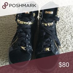Michael Kors high top black shoes Black and gold Michael Kors high top shoes. Gold zippers on the outsides. Michael Kors Shoes Sneakers