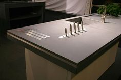 Concrete worktop with build in knife block. Might try it in our concrete countertop project.