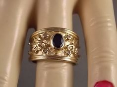 Sapphire and Diamond Cigar Band ring with by estatejewelryshop