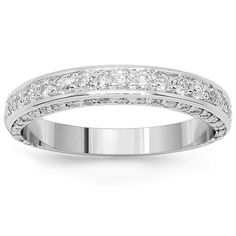 This elegant womens diamond wedding band is pave set with brilliant round cut diamonds which weigh a total of 1.21 carats. The band is crafted in highly polished 14K White Gold and weighs approximately 4.4 grams. Measuring to 1/8 Inches in width, this womens diamond wedding band gleams with exquisiteness and sophistication. $1,762.00