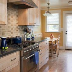 maple, black granite, cork floor, awesome range, light backsplash...