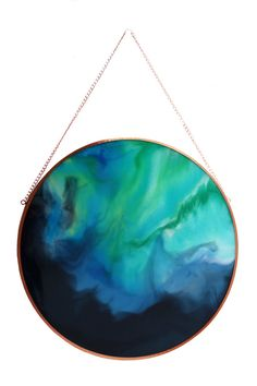 Swirly Pop is one of our favourite pieces in our collection! A classic colour combination with swirls of midnight blue, aquas and greens. This 55cm round resin artwork has been created on glass using super clear high quality resin and acrylic mediums. It comes ready to hang in a beautiful copper frame. Custom orders are available on request. Our artwork is lovingly packed with many layers to ensure a safe arrival to its new home. :)
