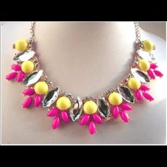 Pink/yellow statement necklace  Brand new necklace, never worn. Gold color chain. Jewelry Necklaces