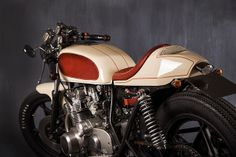 Vintage Motorcycles Suzuki Race Cream ~ Return of the Cafe Racers - Considering they have been around since the early and that they have produced a few historically significant motorcycles in that time, I haven't Moto Cafe, Cafe Bike, Cafe Racer Bikes, Cafe Racer Motorcycle, Motorcycle Outfit, Cafe Racers, Motorcycle Design, Motorcycle Helmets, Suzuki Cafe Racer