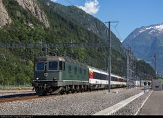 """A very unique view is a Re 6/6 locomotive, pulling a passenger train! Decades ago, this was daily business on the Gotthard line, but since january 2003 this six axle 10600 HP """"powerhouses"""" are strictly in the freight service. For a charter train of the Federal Office of Transport (FOT/BAV) from Bellinzona to Olten, the Re 6/6 # 11663 with the blazon of Eglisau (missing on this side, it was stolen some years ago, sadly) was ordered. The train had 6 first class Apm61 cars and a """"Salon…"""