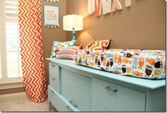 This is the happiest little nursery ever! Brown/ orange/ aqua and supah cute!