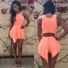 Peach Asymmetrical one piece. Nylon Asymmetrical One piece outfit.   Belt not included. (But is available for sale)  Shorts are underneath.   Has some stretch & same material as American Apparel Shiny leggings. (Not brand listed) American Apparel Dresses Mini