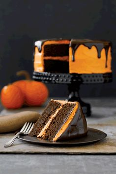 A touch of pumpkin gives this bewitching cake a look and taste that reflects the season.  Glaze: After topping with an Orange Cream-Cheese Frosting, give your cake a cascading chocolate glaze. Place 4 ounces of chopped bittersweet chocolate, 1 tablespoon cold unsalted butter, and 3 tablespoons corn syrup in a medium heatproof bowl. Bring 1/2 cup heavy cream to a boil, pour it over the chocolate, and let sit for 3 minutes. Gently stir, using a whisk, until smooth. Let sit for 3 to 5 minutes…