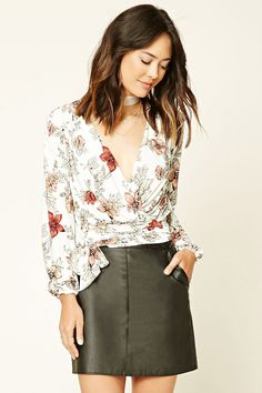 Forever 21 Contemporary - A stretch knit top featuring an allover floral print, surplice front, a self-tie waist, and long elasticized sleeves.