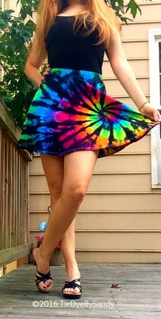 This short and sassy tie-dye skater skirt is a much needed fun addition for your Summer wardrobe. Dyed in bold Inverted Rainbow colors for a slightly edgy look. This mini skater skirt is such a flattering cut on every body type. It sits high on the waist accentuating your curves. It falls mid-thigh, so its not too long, yet not too short.  Available in sizes: Small, Medium, and Large 95% cotton/ 5% spandex 1 inch elastic waistband