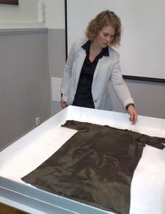 Unearthed ~ Glacial melt resulting from global warming will have untold negative consequences for our planet, but for the time being, it is a boon for archeologists, as valuable artifacts emerge from the ice. In south Norway, it helped to reveal a pre-Viking tunic estimated to be from around the year 300 AD. (Photo: Alister Doyle/Reuters)