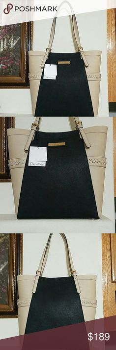 Calvin Klein Tote Beautiful brand new with tag Calvin Klein tote. Saffiano leather. Double handles. Gold tone hardware. Black and wheat color. 1 zip pocket and 2 slip pockets inside. Exterior features 2 slip pockets on the sides. No stains or damages. Approx measurements provided. Calvin Klein Bags