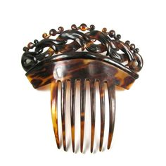 BOOK PIECE A Large RARE Victorian Genuine Tortoise Shell Hair Comb Circa 1860. $360.00, via Etsy.