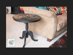 Black side table with writing