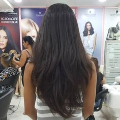 Long Thick Black Hair with Layering Resulting in a Gorgeous V Shape