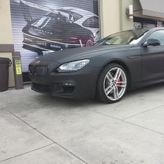 BMW 6series wrapped in matte & gloss black combo with burnt orang - http://www.stickercity.com/sc-vehicle-wraps/bmw-6series-wrapped-in-matte-gloss-black-combo-with-burnt-orang