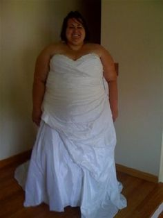 wedding dresses for plus size women - I just love how happy this model looks in this picture!!!