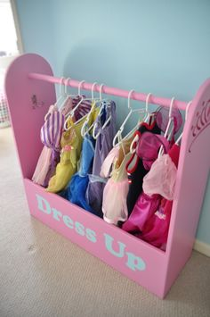 My brother made the girls one of these and they love it.  Perfect storage for all the dresses we have!