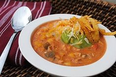 Chicken Taco Soup Recipe:        1/2 onion, diced  1 green pepper, diced  16 oz jar salsa (use your favorite here- I just use ChiChi's medium Original)  32 oz chicken stock  2- 11oz cans Mexicorn, drained  1 1/2 oz package taco seasoning  6 oz tomato paste  1 tsp cumin  2 lb chicken breasts  4 oz cream cheese  1/2 cup sour cream  In large crockpot, combine all ingredients except cream cheese and sour cream. Cook on low heat for 6-8 hours. Half an hour before serving, remove chicken, shred it,...