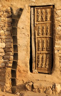 Dogon ladder and carved Dogon door    Mali, Africa