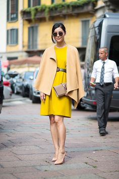 women fashion style clothes bright yellow dress sunglasses camel cream coat heels purse street outfit