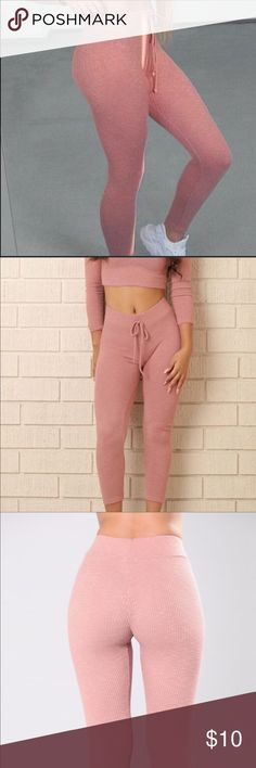 Wanderlust leggings in Dusty Rose Super cute, perfect for spring and summer! These leggings are made from a thicker ribbed material so they offer lots of stretch without being see through. Featuring an tie at the waist (non adjustable) they are perfect with a crop top or cropped hoodie! Beautiful light pink, dusty rose color. Only worn once or twice, they're in great condition! Like new! Fashion Nova Pants Leggings