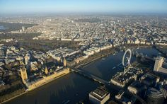 The Palace of Westminster with St James's Park, Green Park and the start of Hyde Park sprawling behind