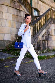 light blue button down shirt, white jeans, royal blue cross-body bag, light blue sandals