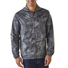 afb3e7f3d76d54 The Patagonia Men s Light   Variable® Hoody is a perfectly pared-down  windbreaker hoody that stuffs into its own pouch for travel ease.