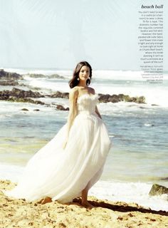 The summer issue of Martha Stewart Weddings brings us sun, sand, and style featuring a barefooted bride in our Rosa gown.
