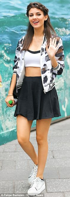 In step with style: The Nickelodeon sensation wore grey platform sneakers and a print  jac...