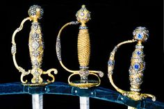 THE ROMANOVS JEWELRY ~ Golden-plated hilts of swords decorated by sapphire, diamonds and crystals performed for the Romanovs and their courtiers by Tzar workshops in the 17-18th centuries. Saved in the Diamond Fund of Moscow Kremlin. Known that Nikolay II had a sword with a hilt decorated by diamonds and gems. Nikolay II took that sword to Tobolsk and Ekaterinburg where it was stolen after his assassination, together with a crown of Alix and her personal casket full of her favorite jewelry ~