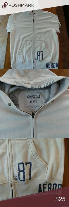 Aeropostale hoodie Used tan with blue lettering hoodie made by Aeropostale.  Feels baby soft.  No holes.  Gently worn.  Feels really good and comfortable as well. Aeropostale Shirts Sweatshirts & Hoodies