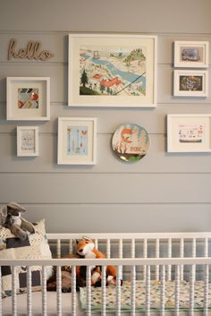 Cute nursery gallery wall  -little round mirror where plate is -- different word instead of hello